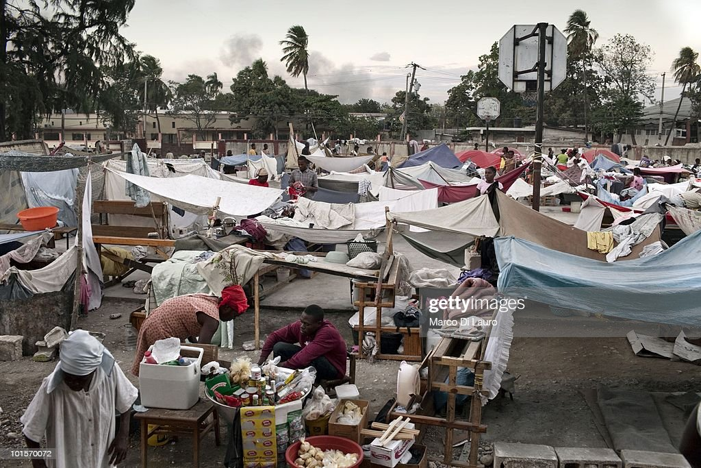 A general view of a temporary camp that was once a school where Save the Children is running a' Child Friendly Space' a safe area for children to play in and a mobile clinic is seen on January 29, 2010 in Port Au Prince, Haiti. As many as 200,000 people died on January 12 as a consequence of the 7.0-magnitude earthquake. At least 130 people have been pulled alive from the rubble. An estimated 1.5 million people have been left homeless. The Haitian government is planning to relocate some 400,000 people, currently in makeshift camps across the capital, to temporary tent villages outside the city. Aid agencies are still struggling to supply food and water to survivors, while thousands of Haitians who suffered serious injuries remain in need of urgent medical attention.