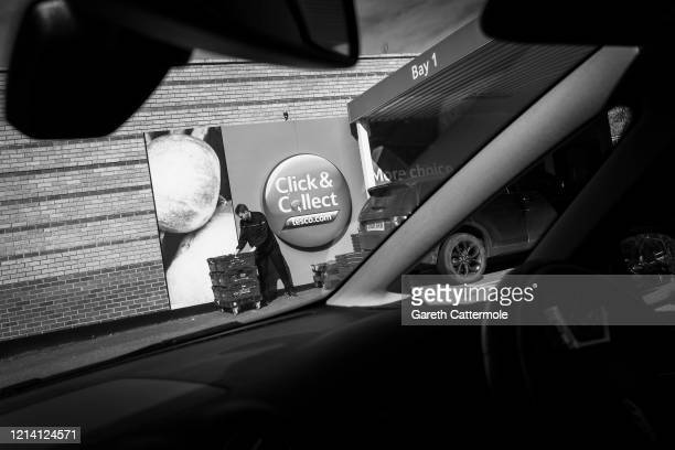 A general view of a Tesco Click Collect pick up point on March 22 2020 in Bishop's Stortford Coronavirus has spread to at least 188 countries...