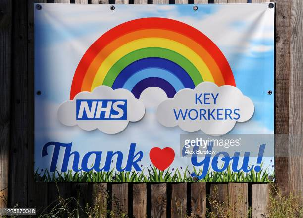 General view of a thank you sign in support of NHS and key workers is displayed on a fence outside a house on May 19, 2020 in Fleet, England. The...