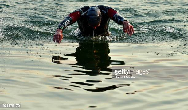 A general view of a triathlete entering the water during the IRONMAN Boulder on June 10 2018 in Boulder Colorado