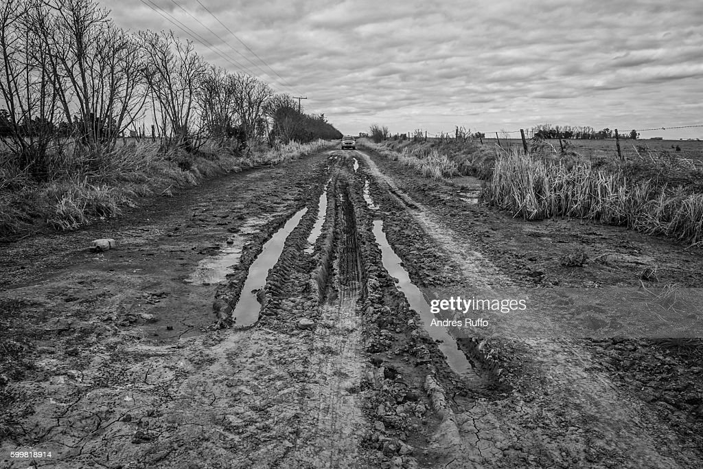 General view of a truck on a rural road in black and white : Stock Photo