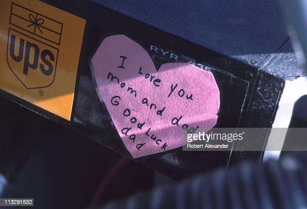 General view of a valentine from one of Dale Jarrett's children is taped to the dashboard of the NASCAR driver's race car at the 2002 Daytona 500 on...