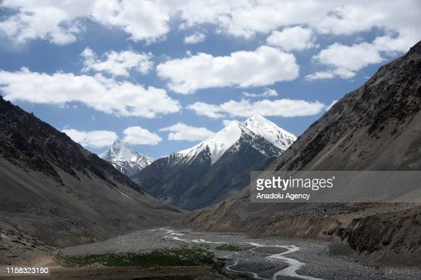 A general view of a valley as the summits of mountains are seen at the background on the Karimabad Region where a number of summits meet and host...
