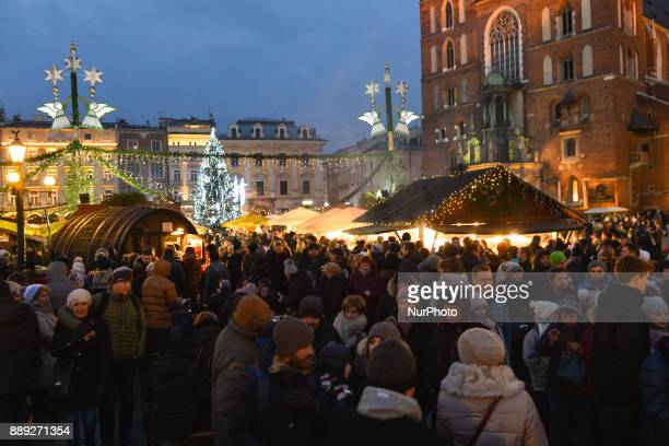 A general view of a very busy Krakow's Christmas Market in the Main Square with thousands of locals and visitors from abroad On Saturday December 9 in