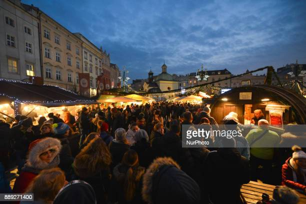 A general view of a very busy Krakow's Christmas Market in the Main Square with thousands of locals and visitors from abroad On Saturday December 9...