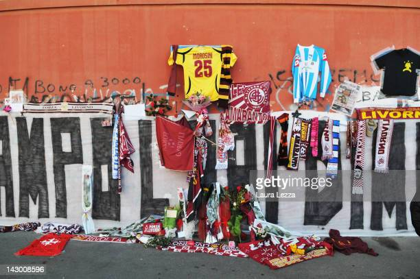 General view of a wall of scarves, graffiti and floral tributes outside Armando Picchi Stadium, where the coffin of footballer Piermario Morosini was...