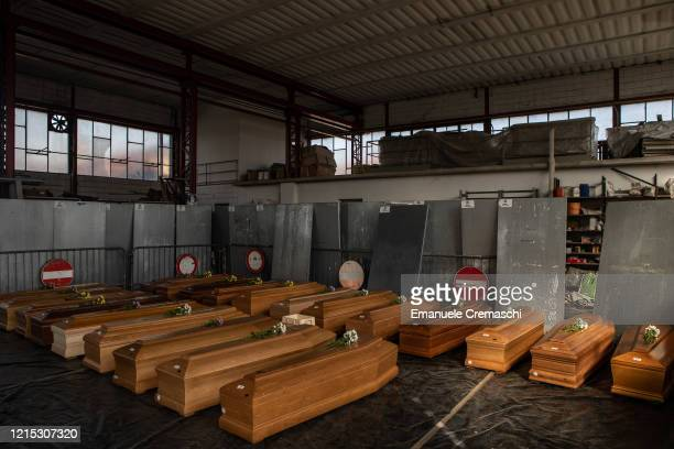 General view of a warehouse used to stock coffins on March 28, 2020 in Ponte San Pietro, near Bergamo, Northern Italy. The Italian Army has been...