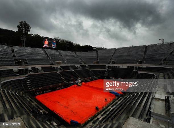 A general view of a wet centre court with Roger Federer of Switzerland due to play Joao Sousa of Portugal delayed by rain during day four of the...