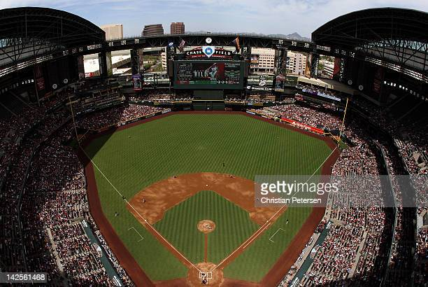 General view of action as Aaron Hill of the Arizona Diamondbacks hits a solo home run off starting pitcher Madison Bumgarner of the San Francisco...