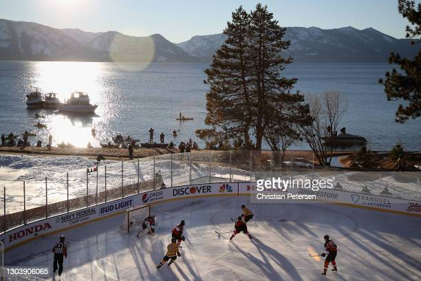 General view of action as David Pastrnak of the Boston Bruins shoots to score a goal against the Philadelphia Flyers during the 'NHL Outdoors At Lake...
