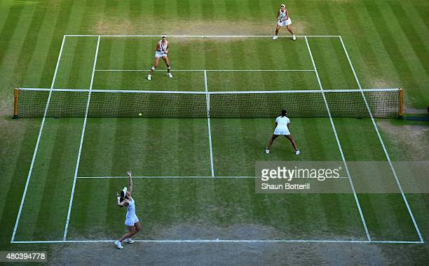 A general view of action as Elena Vesnina of Russia and Ekaterina Makarova of Russia in the Final Of The Ladies' Doubles against Martina Hingis of...