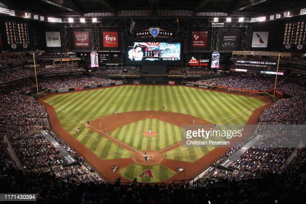General view of action as relief pitcher Pedro Baez of the Los Angeles Dodgers pitches against Nick Ahmed of the Arizona Diamondbacks during the...