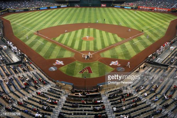 General view of action as starting pitcher Taylor Widener of the Arizona Diamondbacks pitches against the Cincinnati Reds during the first inning of...