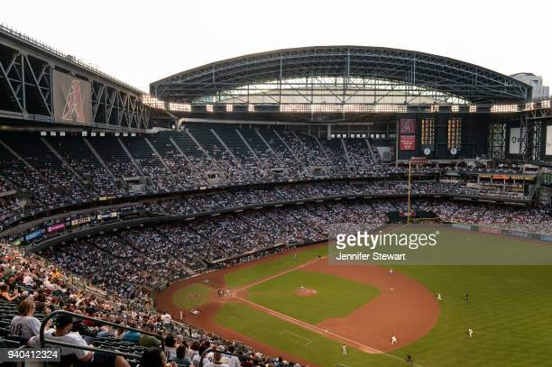 A general view of action as starting pitcher Zack Greinke of the Arizona Diamondbacks delivers a pitch in the MLB game against the Colorado Rockies...
