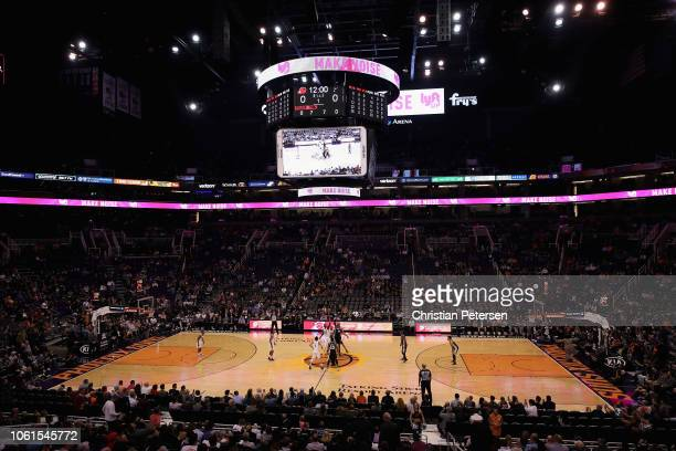 General view of action as the Phoenix Suns and the San Antonio Spurs tipoff during the first half of the NBA game at Talking Stick Resort Arena on...