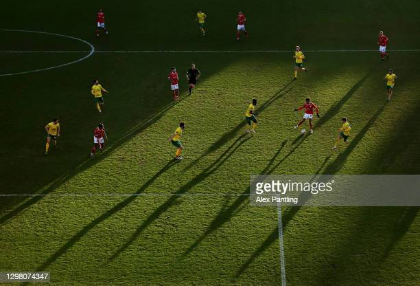General view of action as the sun sets during The Emirates FA Cup Fourth Round match between Barnsley and Norwich City at Oakwell Stadium on January...