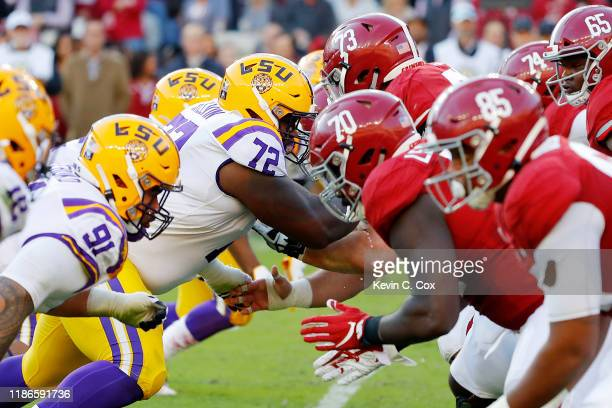 A general view of action between the LSU Tigers defensive line and the Alabama Crimson Tide offensive line during the first half in the game at...