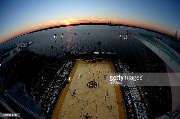 A general view of action between the Ohio State Buckeyes and the Notre Dame Fighting Irish as the sun sets during the Walmart Carrier Classic on the...