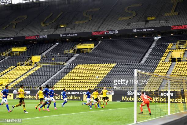 A general view of action during the Bundesliga match between Borussia Dortmund and FC Schalke 04 at Signal Iduna Park on May 16 2020 in Dortmund...