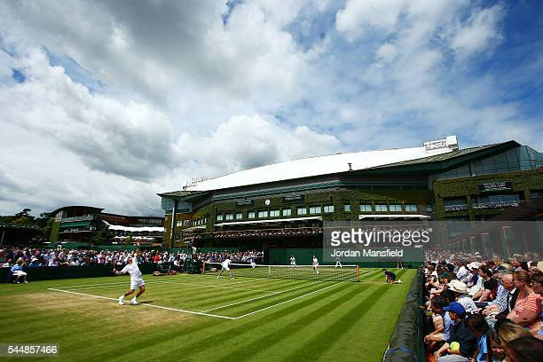 A general view of action on court seven on day seven of the Wimbledon Lawn Tennis Championships at the All England Lawn Tennis and Croquet Club on...