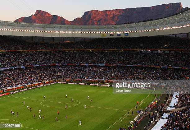General view of action showing Table Mountain at sunset in the background during the 2010 FIFA World Cup South Africa Quarter Final match between...