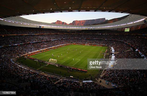 A general view of action showing Table Mountain at sunset in the background during the 2010 FIFA World Cup South Africa Quarter Final match between...