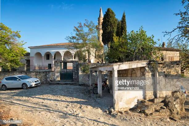 general view of adatepe village mosque ,ayvacik. - emreturanphoto stock pictures, royalty-free photos & images