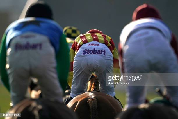A general view of advertising carried by the jockeys at Cheltenham Racecourse on December 14 2018 in Cheltenham England