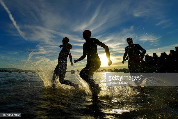 General view of age group triathletes entering the water at the swim start during the IRONMAN 70.3 Indian Wells La Quinta on December 9, 2018 in...