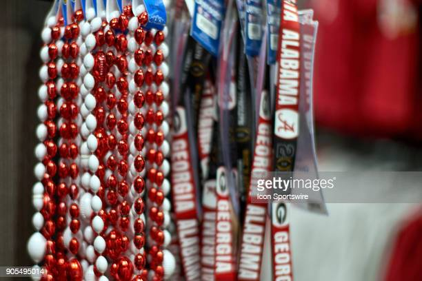 A general view of Alabama Crimson Tide and Georgia Bulldogs fans bead necklaces and paraphernalia are seen at a CFP gift shop during the College...