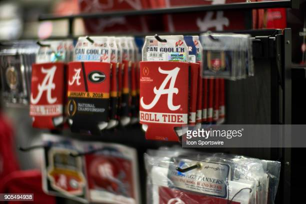 A general view of Alabama Crimson Tide and Georgia Bulldogs fans beer can holders and paraphernalia are seen at a CFP gift shop during the College...
