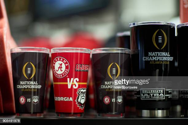 A general view of Alabama Crimson Tide and Georgia Bulldogs fans cups coffee mugs and paraphernalia are seen at a CFP gift shop during the College...