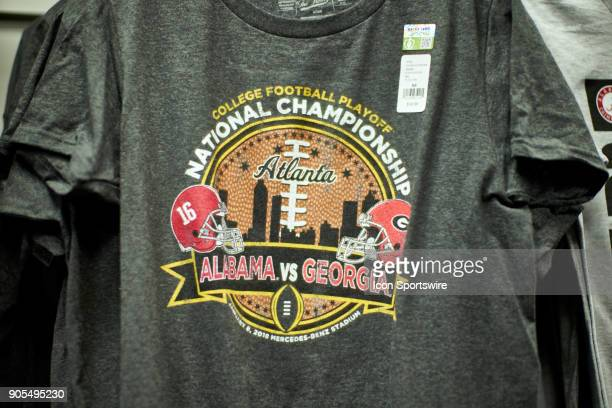A general view of Alabama Crimson Tide and Georgia Bulldogs fans tee shirts and paraphernalia are seen at a CFP gift shop during the College Football...