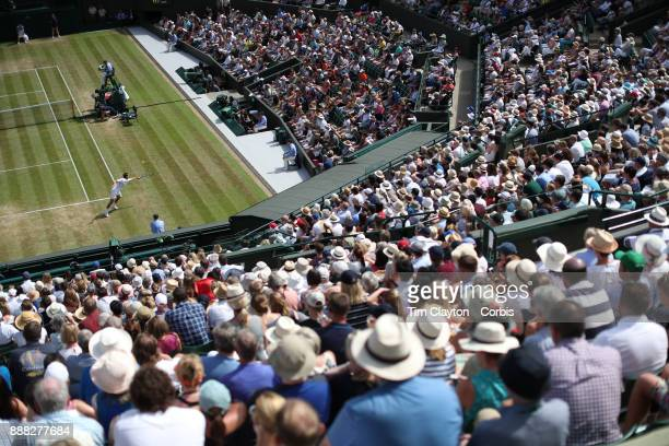 A general view of Albert RamosVinolas of Spain in action against Milos Raonic of Canada on number one court during the Wimbledon Lawn Tennis...