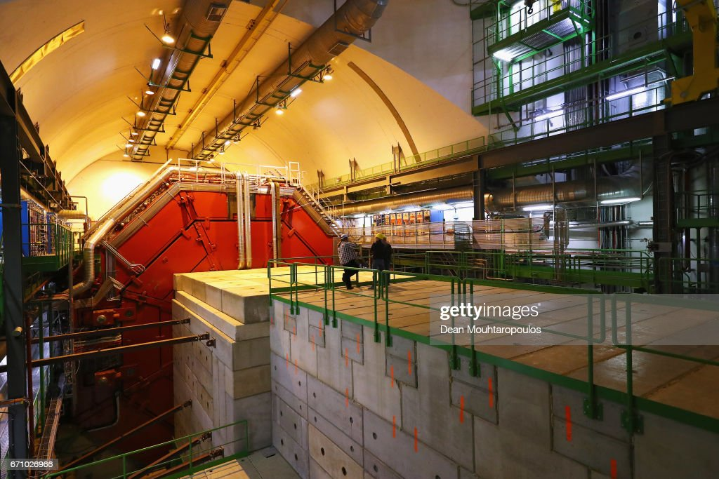 A general view of ALICE (A Large Ion Collider Experiment) cavern and detector during a behind the scenes tour at CERN, the World's Largest Particle Physics Laboratory on April 19, 2017 in Meyrin, Switzerland. ALICE (A Large Ion Collider Experiment) is a heavy-ion detector on the Large Hadron Collider (LHC) ring. It is designed to study the physics of strongly interacting matter at extreme energy densities, where a phase of matter called quark-gluon plasma forms. The ALICE detectors weighs 10,000-tonne and is 26 m long, 16 m high, and 16 m wide. It sits in a vast cavern 56 m below ground close to the village of St Genis-Pouilly in France.
