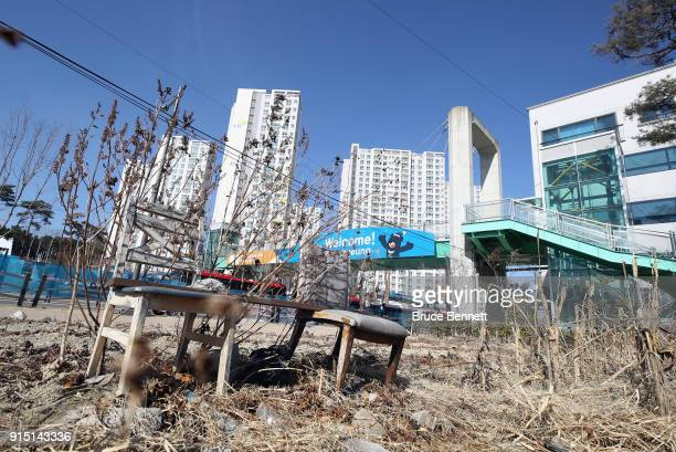 A general view of an abondoned lot and the Gangneung Olympic Village ahead of the PyeongChang 2018 Winter Olympic Games on February 7 2018 in...