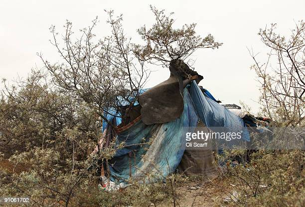 A general view of an Afghan migrant's makeshift shelter erected adjacent to the Calais ferry terminal on September 23 2009 in Calais France The...