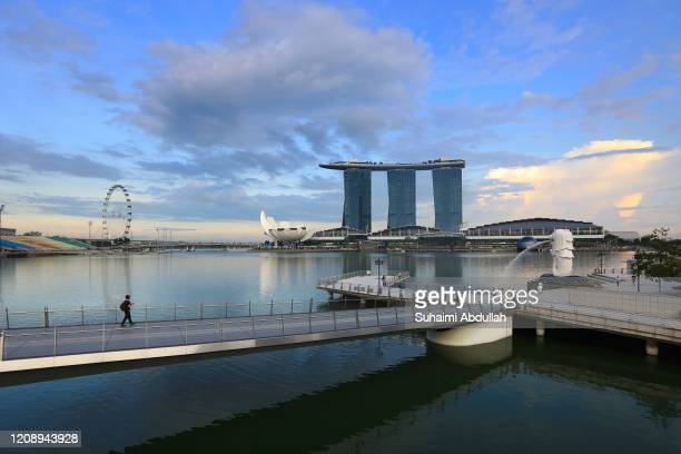 General view of an almost empty tourist attraction at a normally busy Merlion Park with the Singapore Flyer, Marina Bays Sands and the ArtScience...