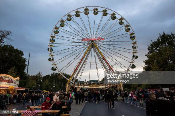 A general view of an amusement area set up along 17th of June Street in Tiergraten Park near the Brandenburg Gate on German Unity Day on October 3...