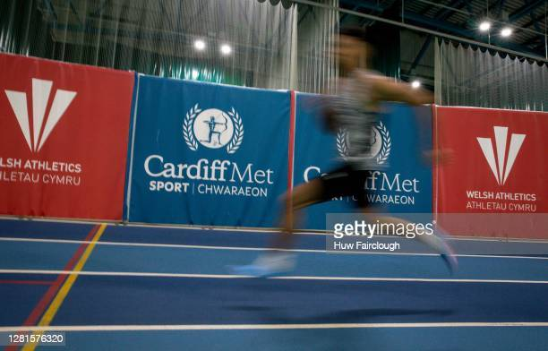 General view of an athelete sprinting on an indoor athletics track on October 21, 2020 in Cardiff, Wales. The Welsh Government has announced a...
