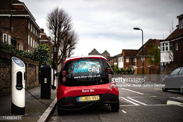 a general view of an electric vehicle charging - basak gurbuz derman stock photos and pictures