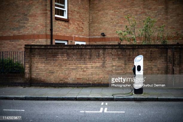 a general view of an electric vehicle charging station - basak gurbuz derman stock photos and pictures