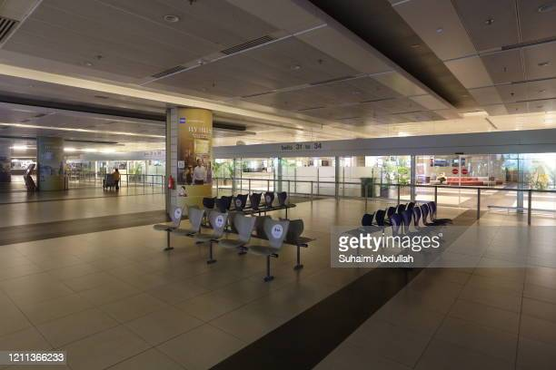 General view of an empty arrival hall at Changi Airport Terminal 2 on April 30, 2020 in Singapore. Changi Airport Terminal 2 will suspend operations...