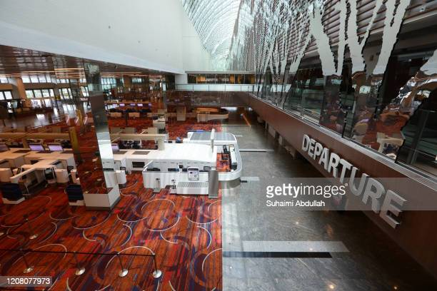 A general view of an empty check in counters at Changi Airport on March 24 2020 in Singapore Singapore will not allow short term visitors to enter or...