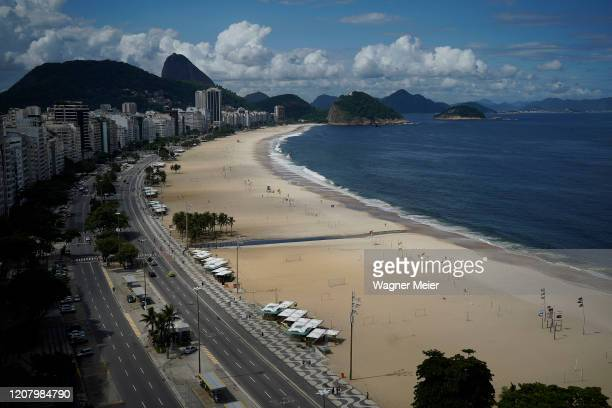 General view of an empty Copacabana Beach during a lockdown aimed at stopping the spread of the coronavirus pandemic on March 22, 2020 in Rio de...