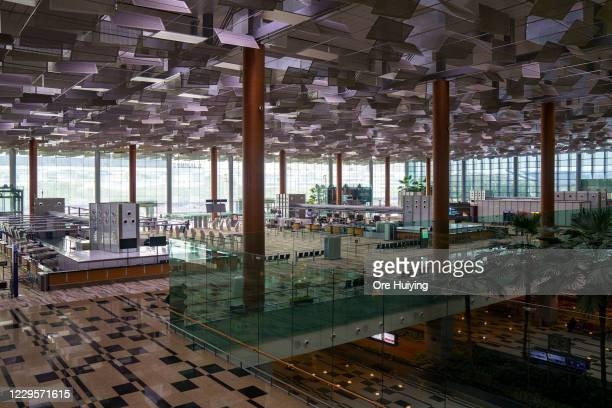 General view of an empty departure hall of Changi Airport Terminal 3 on November 11, 2020 in Singapore. Singapore and Hong Kong authorities announced...