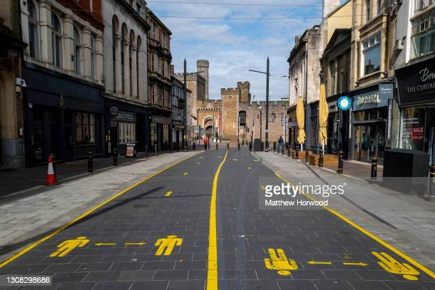 General view of an empty High Street with social distancing lanes painted on the pavement on March 18, 2021 in Cardiff, Wales. Wales First Minister...