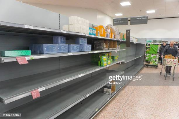 General view of an empty shelve with toilet tissues is seen in Waitrose, Sheffield, UK as shoppers due to panic buying of essential goods during the...