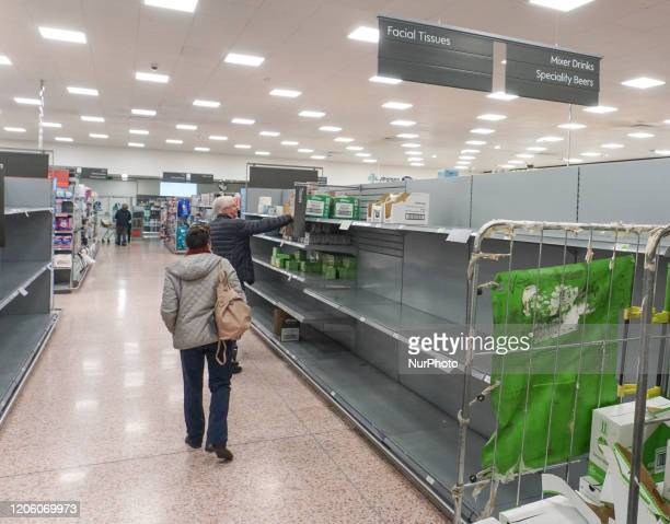 A general view of an empty shelve with toilet tissues is seen in Waitrose Sheffield UK as shoppers due to panic buying of essential goods during the...