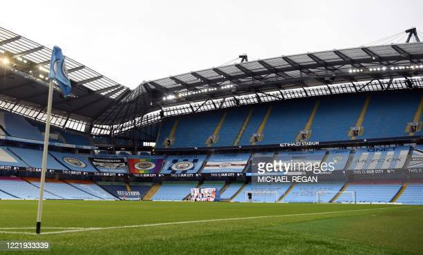A general view of an empty stadium ahead of the English Premier League football match between Manchester City and Burnley at the Etihad Stadium in...
